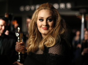 "Singer Adele, winner of the Oscar for best original song for ""Skyfall,"" is interviewed at the Governors Ball for the 85th Academy Awards in Hollywood, California February 24, 2013.   REUTERS/Lucas Jackson (UNITED STATES TAGS:ENTERTAINMENT) (OSCARS-PARTIES) - RTR3E9IW"