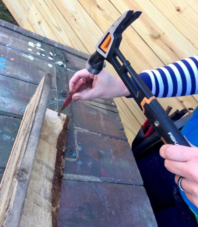 using nail set and hammer