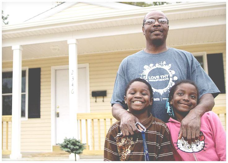 Family in front of Habitat for Humanity home