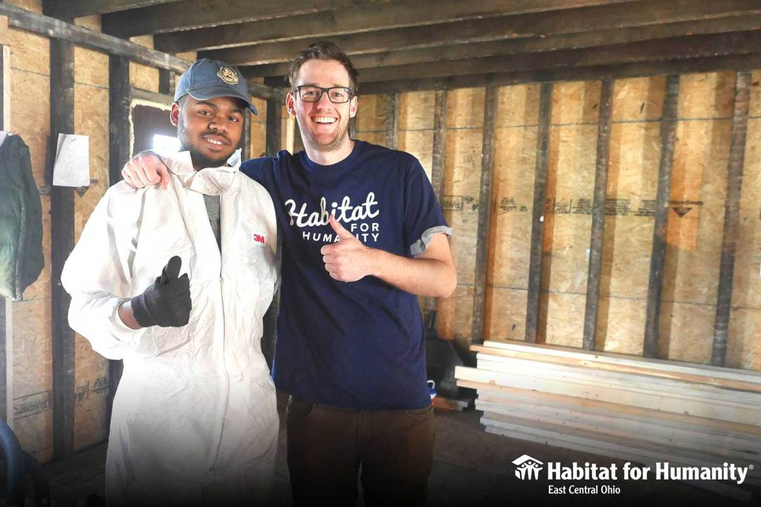 Dave offers a thumbs up for Habitat for Humanity volunteers