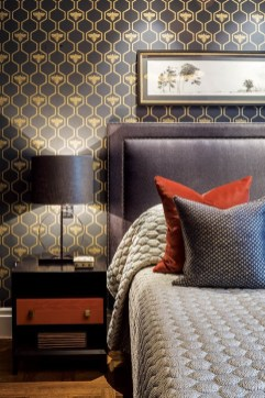36 - The boy's bedroom has a darker, more masculine feel in navy and gold with rust highlights