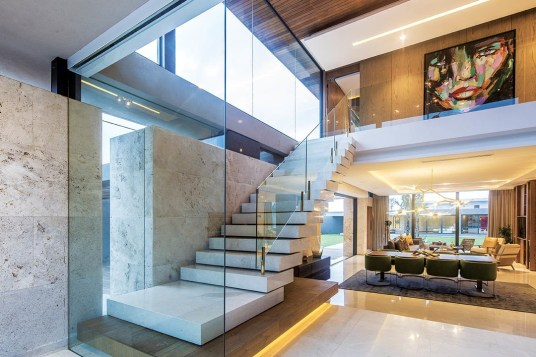The interior features leather, timber, copper and stone wall cladding, specific and unique for each space.