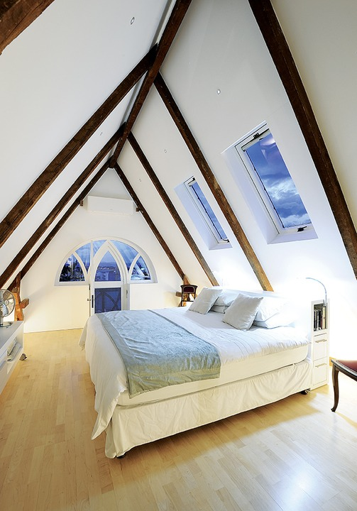 Natural light floods this refurbished attic.