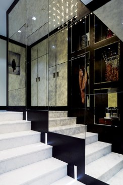 Carrara marble is used to good effect in the entrance hall; a mirrored wall completes the picture.
