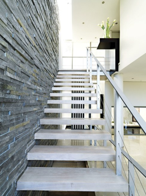 The stairwell is a focus of attention – leading to the sleeping quarters on the upper floor.