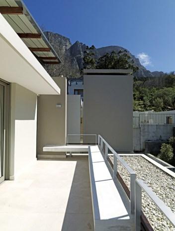 Contemporary home on a verdant stretch of Cape mountainside.