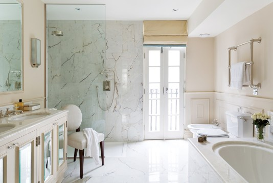 This includes Portuguese Rosa Aurora Light marble for the master bathroom.