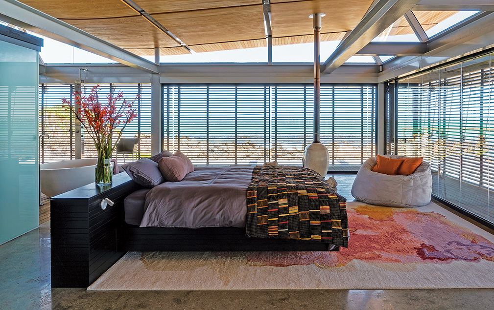 Shutters in the bedroom are now permanent fixtures that protect against the extremes of coastal climate, while also fulfilling a security role.