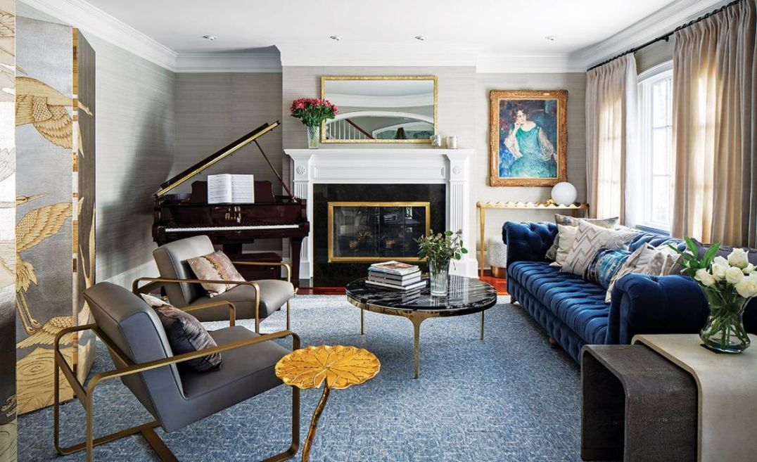 In the formal living room, the rug is of a lightly-patterned abstract style in soft blues and greys, hand-knotted in India, using denim bamboo silk.