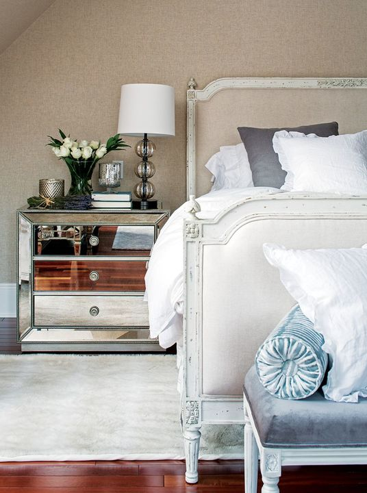 The synergy of styles extends to the main bedroom where traditional elements are used in tandem with Art Deco touches, such as the bedside tables.