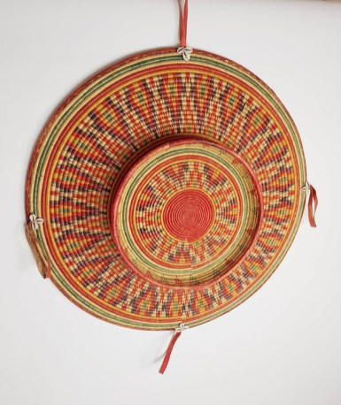 Kezhia Orege Harari tribe basket Ethiopia mid 20th century 75.5 cm high x 75.5 cm wide The Harari tribe from the East of Ethiopia are renowned for their skill of basketry making. The traditional complex patterns, shapes, and colours in the basketry was an arduous and intricate task that required great skill. The various patterns on the basket was a reflection of the cultural history of the tribe within the community. The basket would have been used for wall adornment, presentation of food on special occasions, also a gift to mother in law of the bride. Masterpiece of the basket making and its display in an homestead was a revered aesthetic Art. The display of the basketry demonstrated the epitome of this fine Art by the woman who were the only producers of the baskets. Ex collection of an English collector, who lived in Addis Ababa in the 70s.