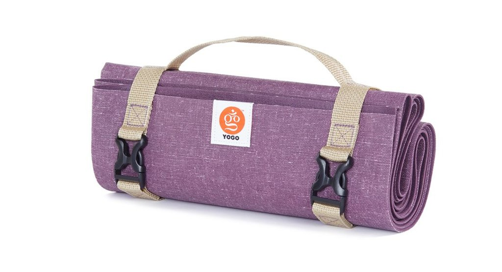 rolled up purple yoga mat