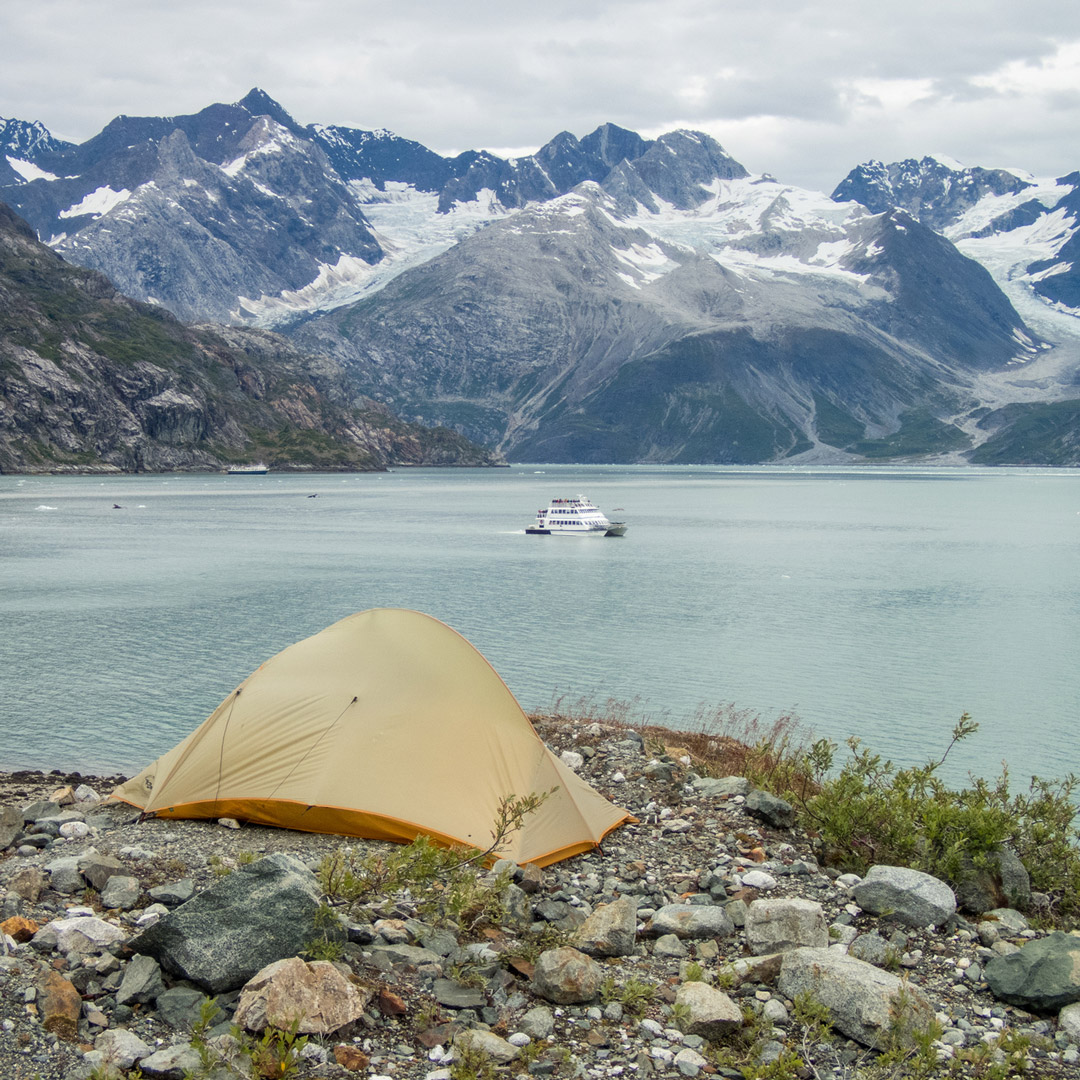 a tent sits on the shore of Glacier Bay
