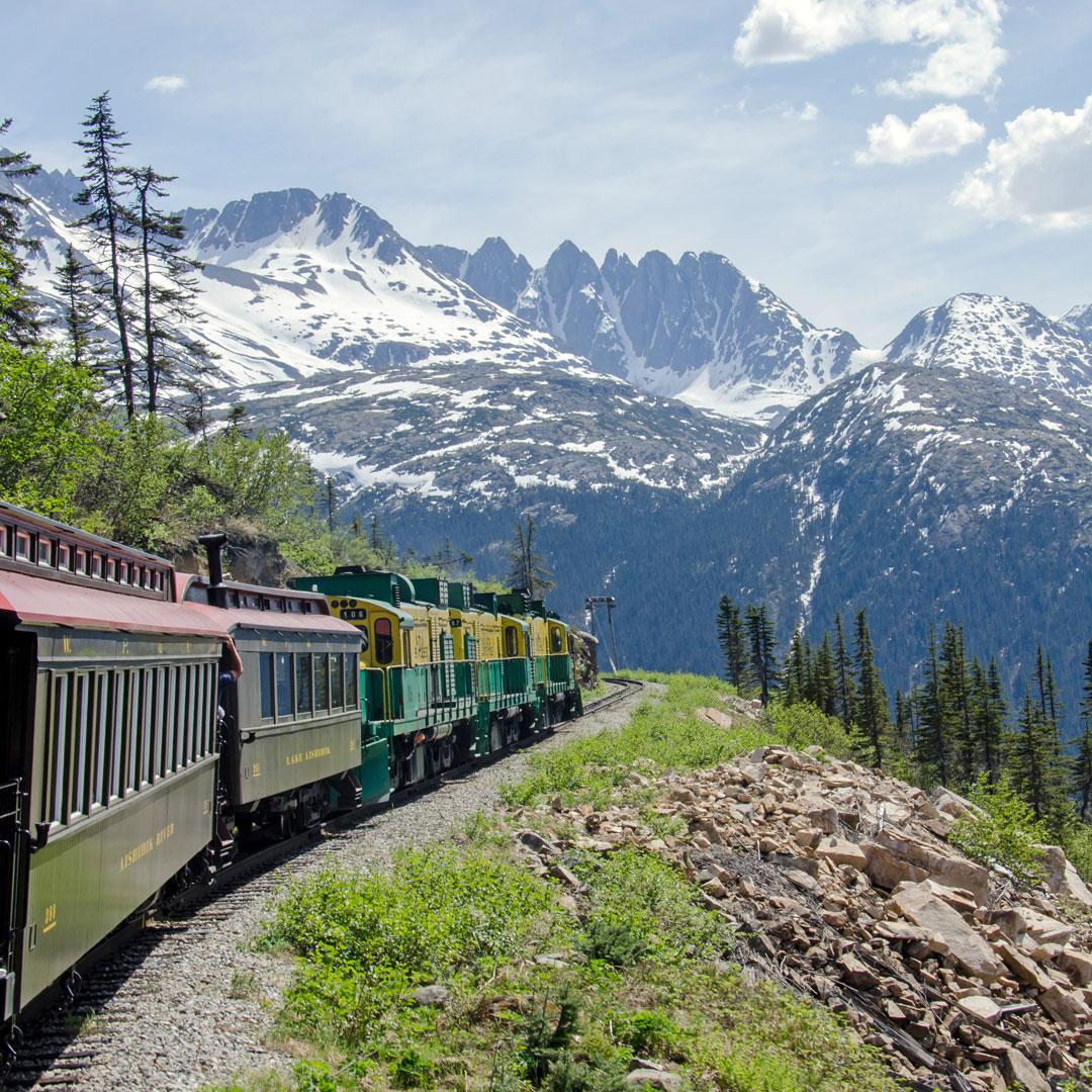 Train headed through Alaskan mountains