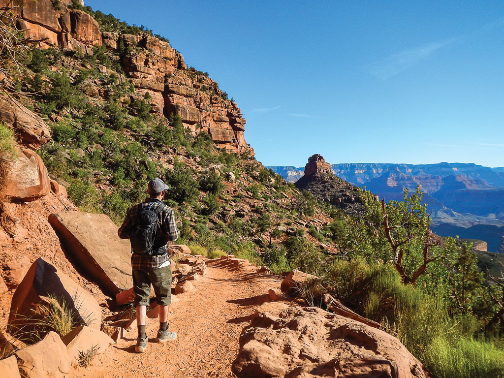 hiker walkinga long the bright angel trail in grand canyon national park