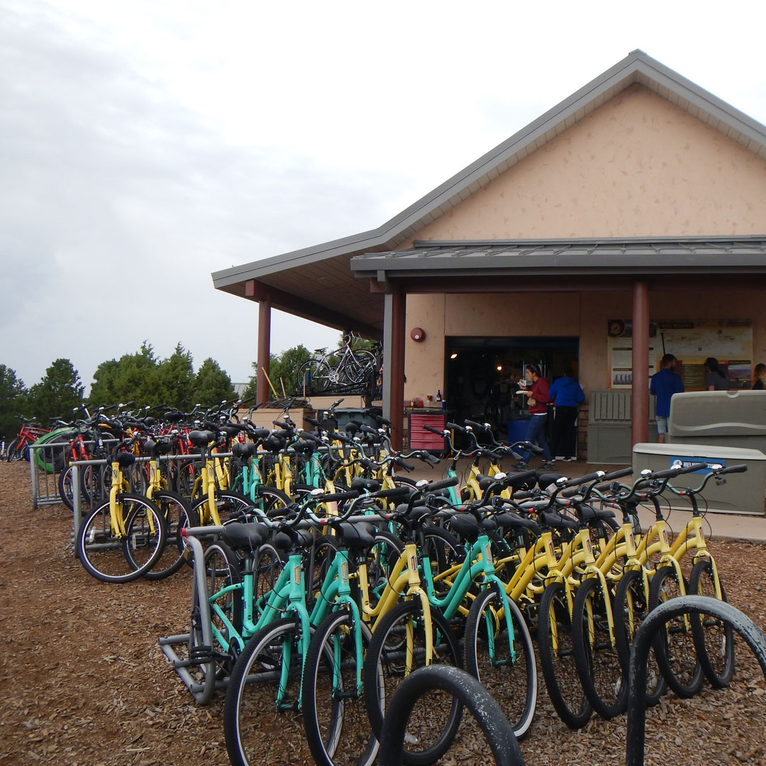 green and yellow bikes parked in front of a building in Arizona
