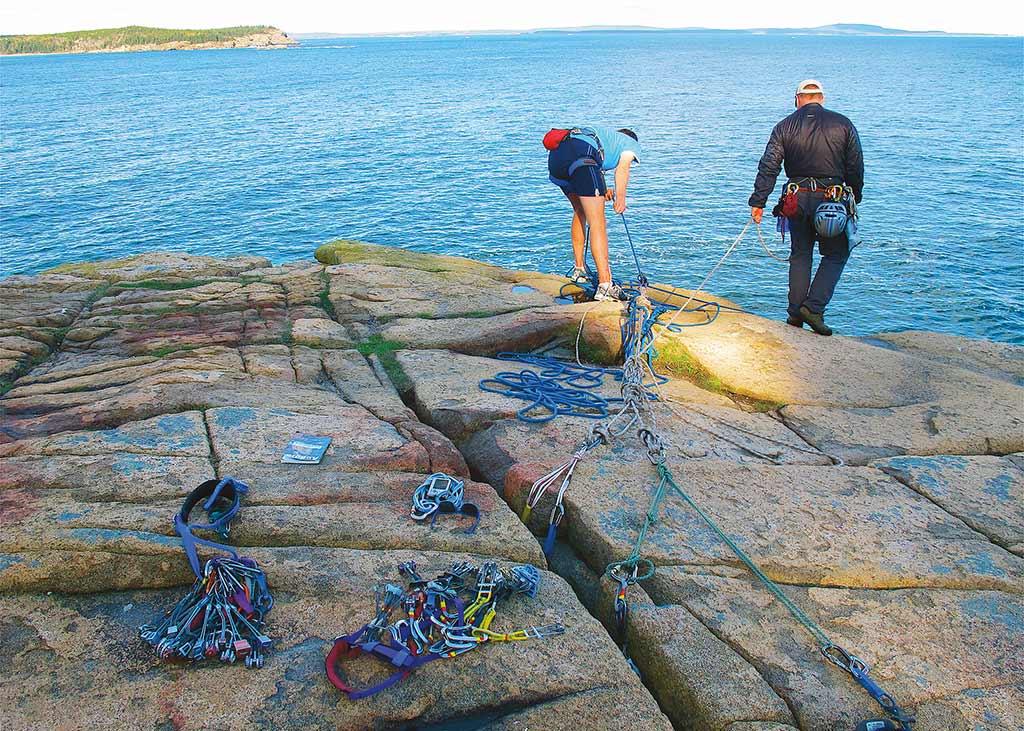 Climbers prepare to scale Acadia's granite cliffs