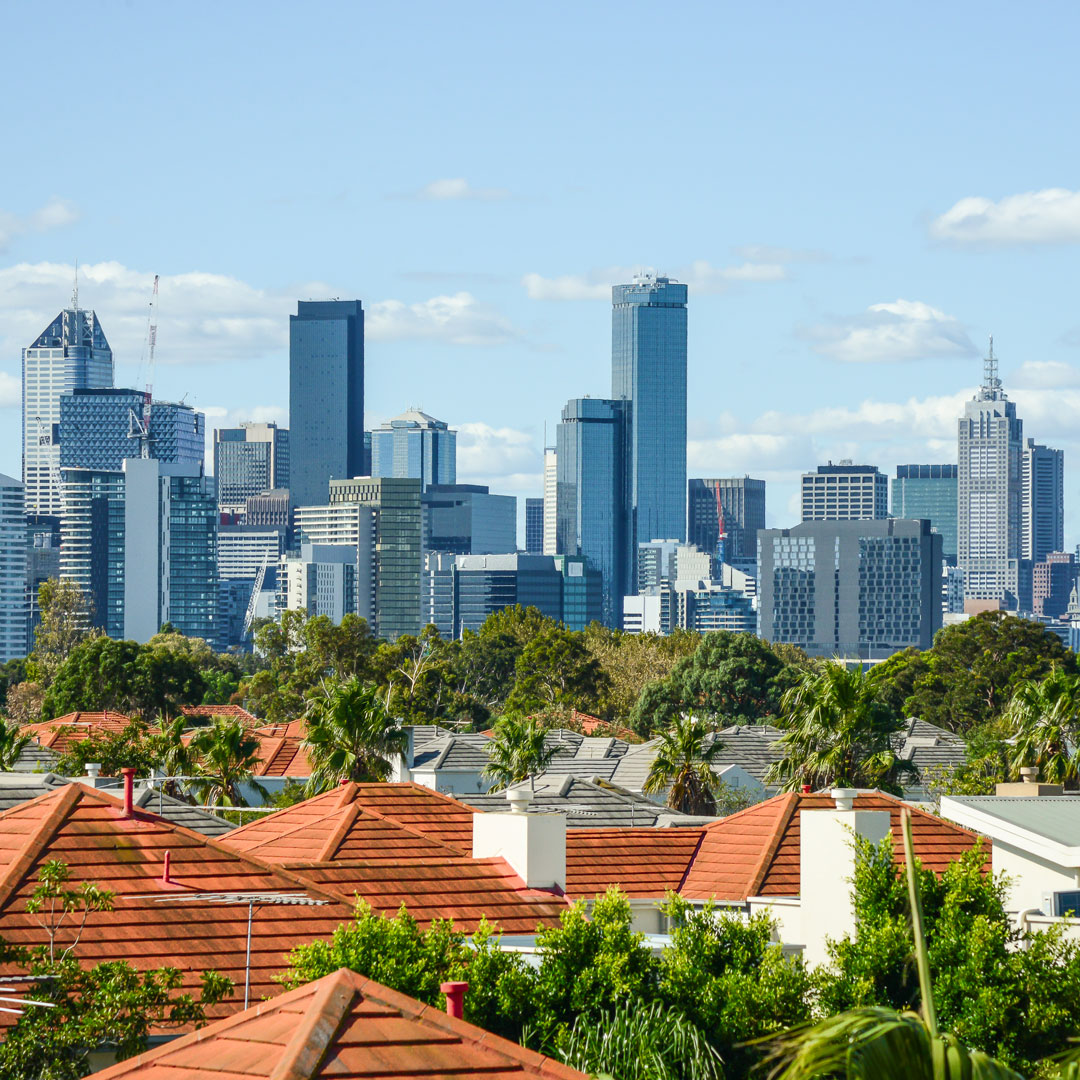 view of the Melbourne skyline over suburban houses