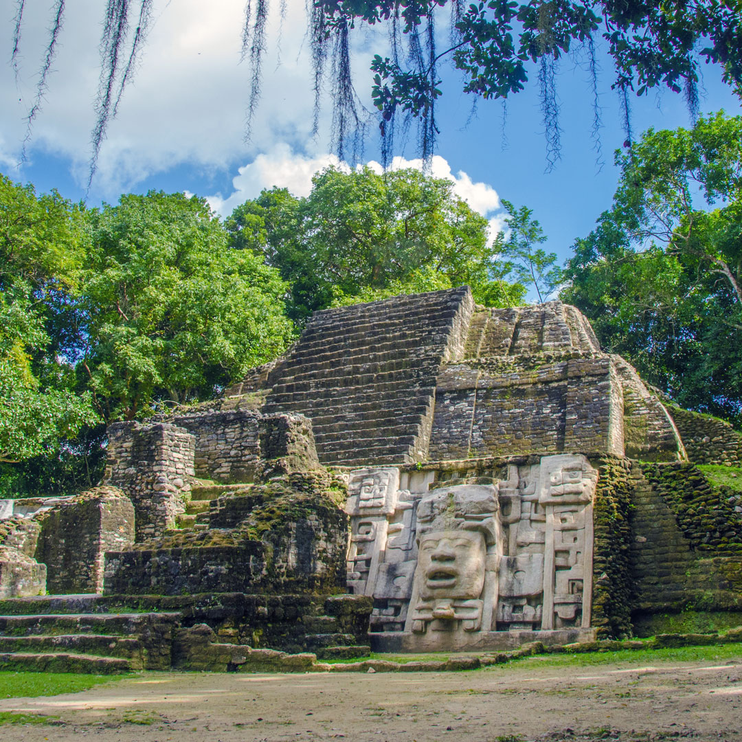 temple of Lamani Ruins in Belize surrounded by trees