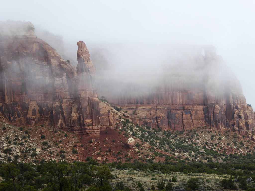 mist surrounding sandstone in Colorado National Monument