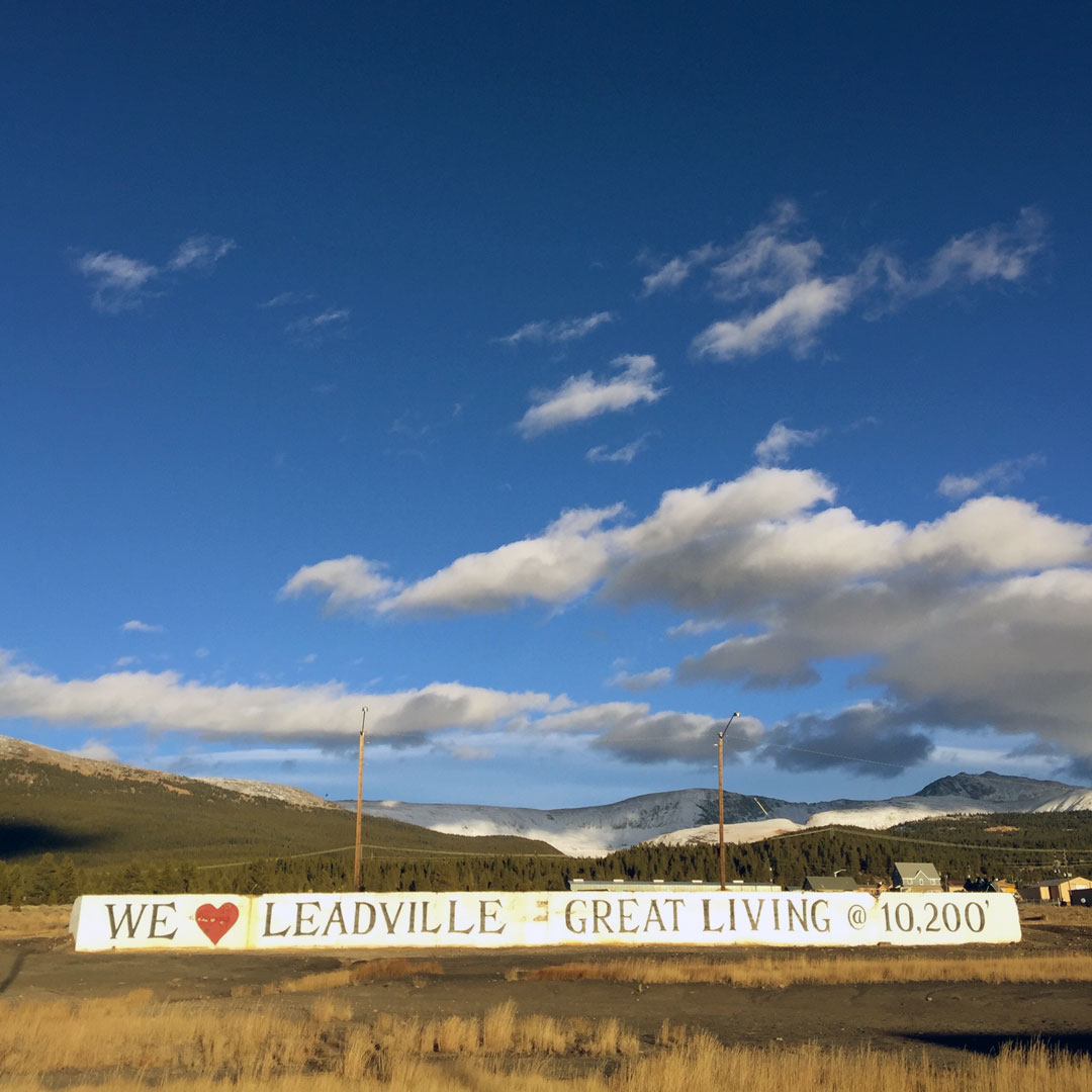 Sign in a field that says - We Love Leadville