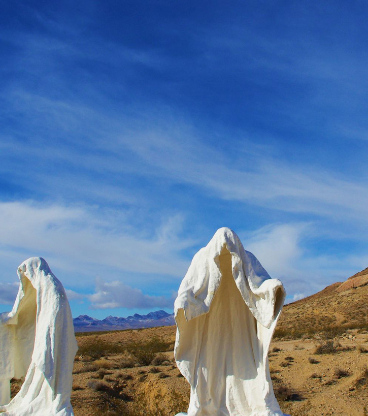 The art piece The Last Supper features ghostly life-size hollow figures against a desert background.