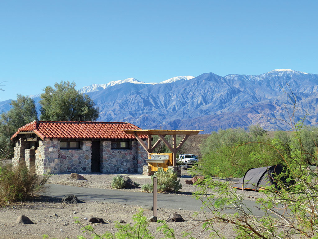 bathrooms and a tent in a Furnace Creek campground Death Valley