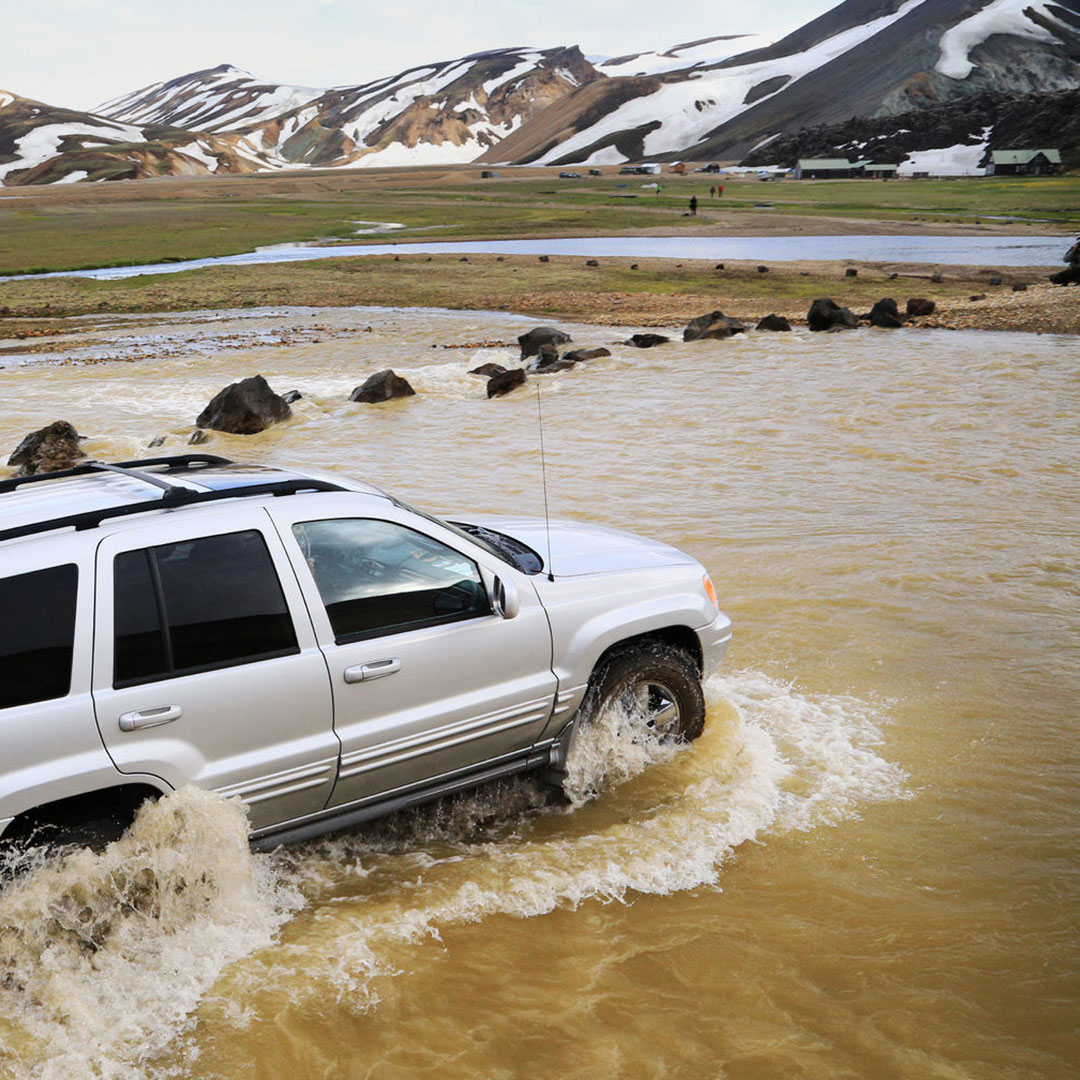 A 4x4 crossing a river in Iceland.