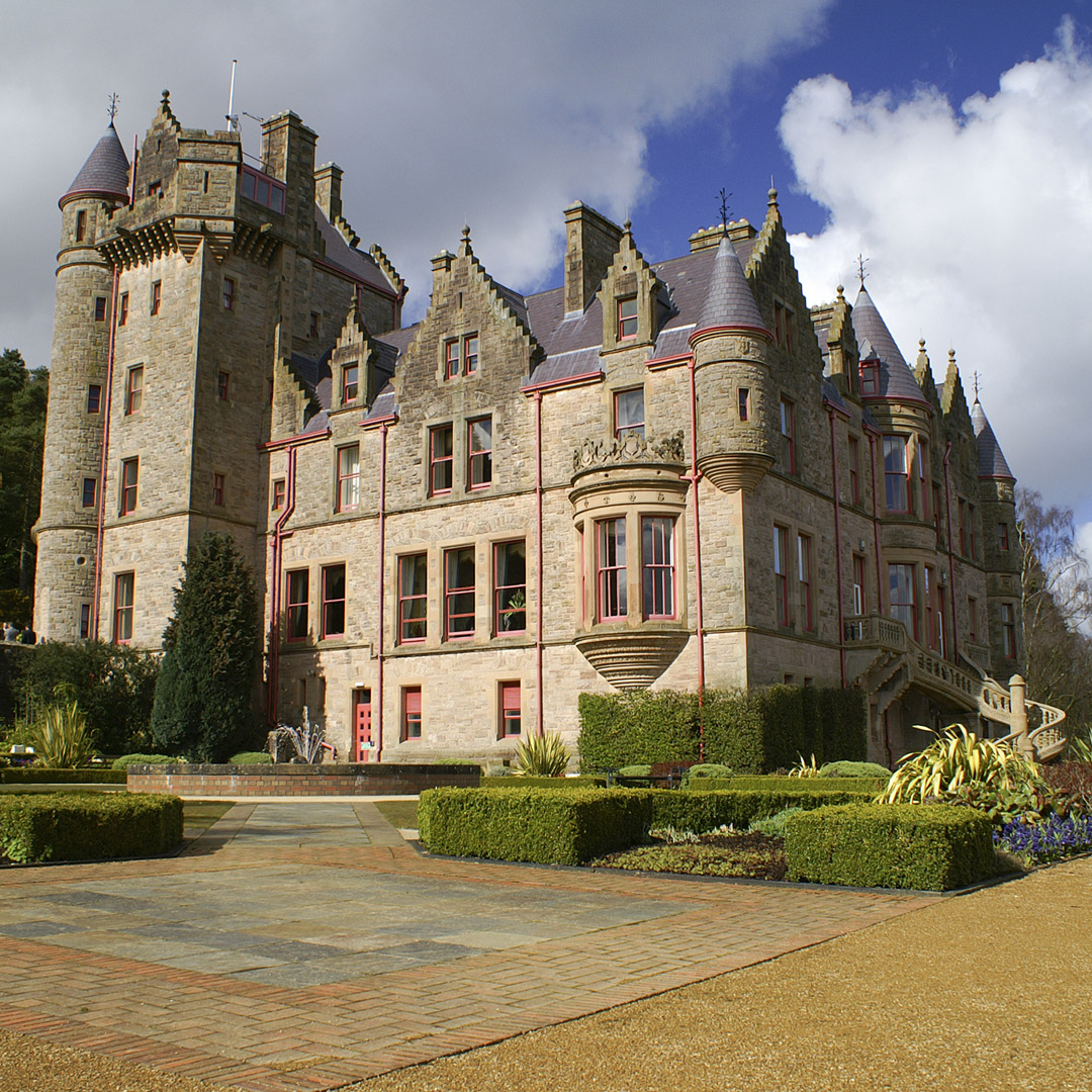 Belfast Castle towers into a cloudy sky in Ireland