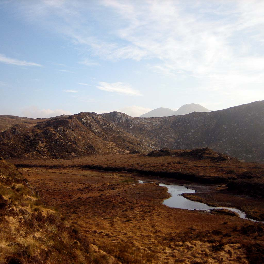 A river cuts through the valley in Ireland's Connemara National Park.