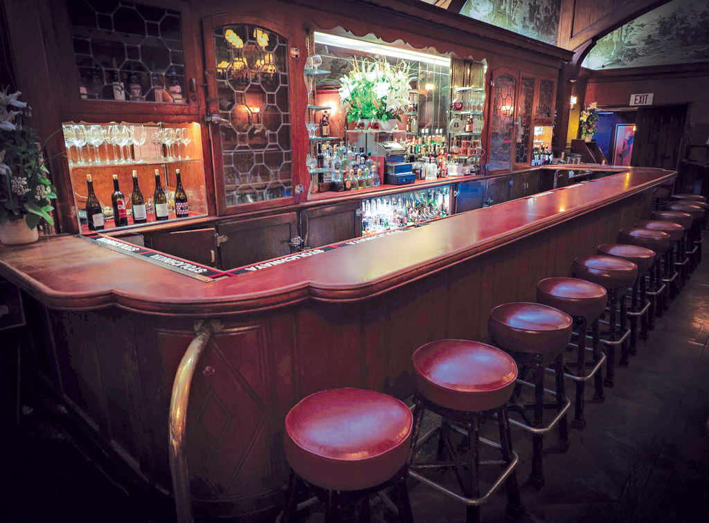 red-toned bar with barstools
