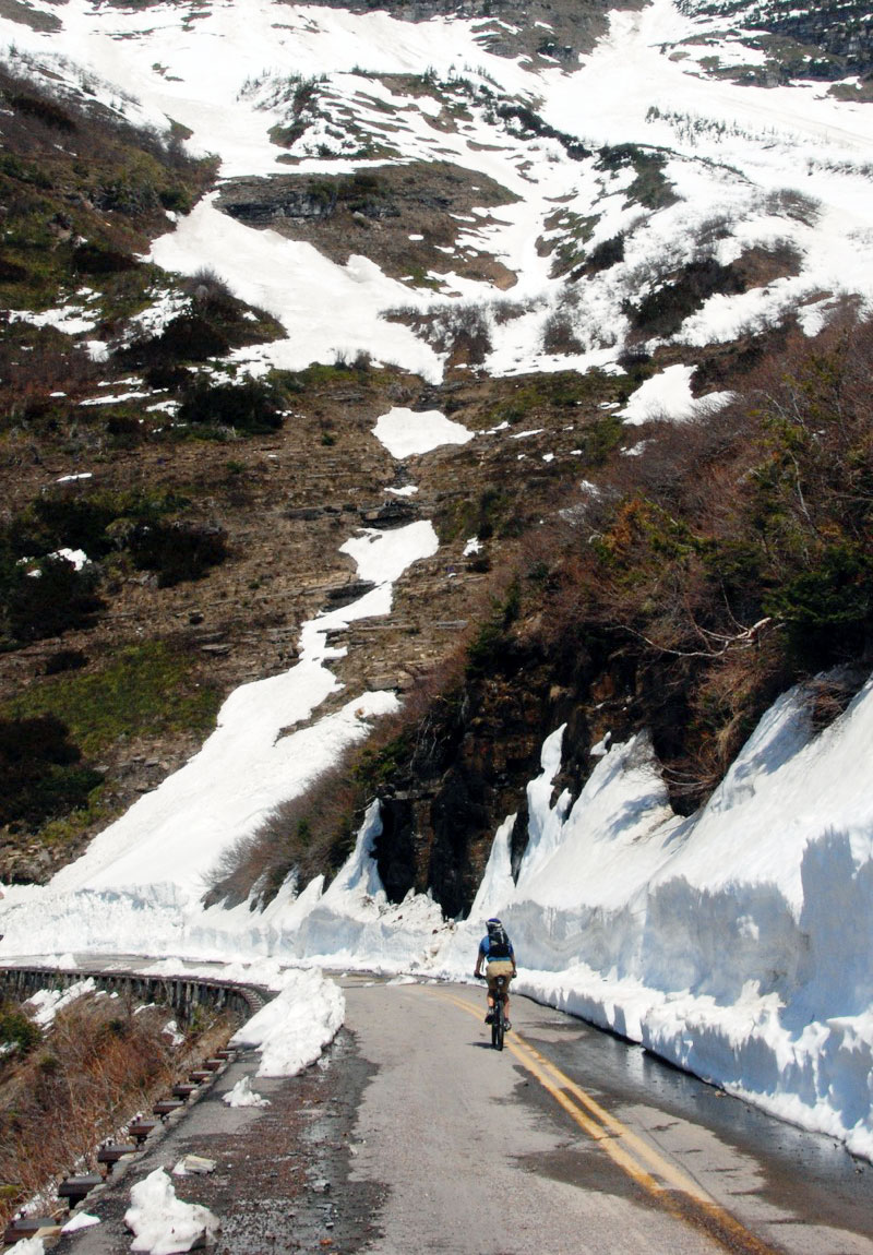 The bicycle season launches mid-April when plows dig down to free the Sun Road of snow.