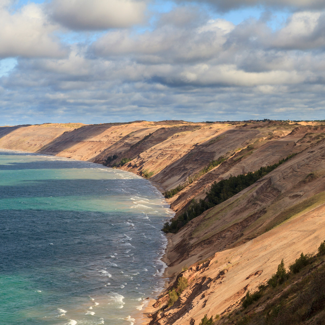clouds gather and cast shadows over grand sable dunes in Pictured Rocks National Lakeshore