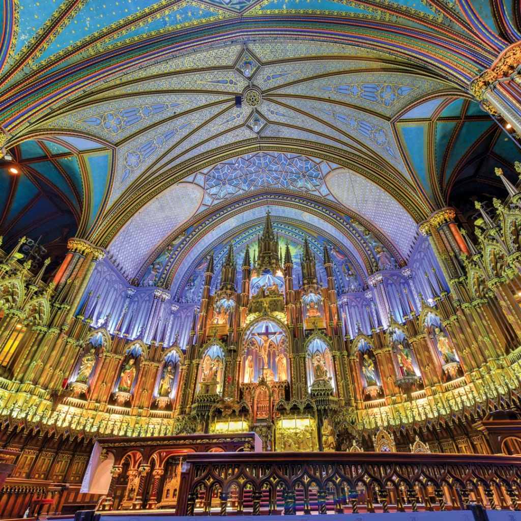 view of the colorful ceiling architecture inside the Notre Dame Basilica