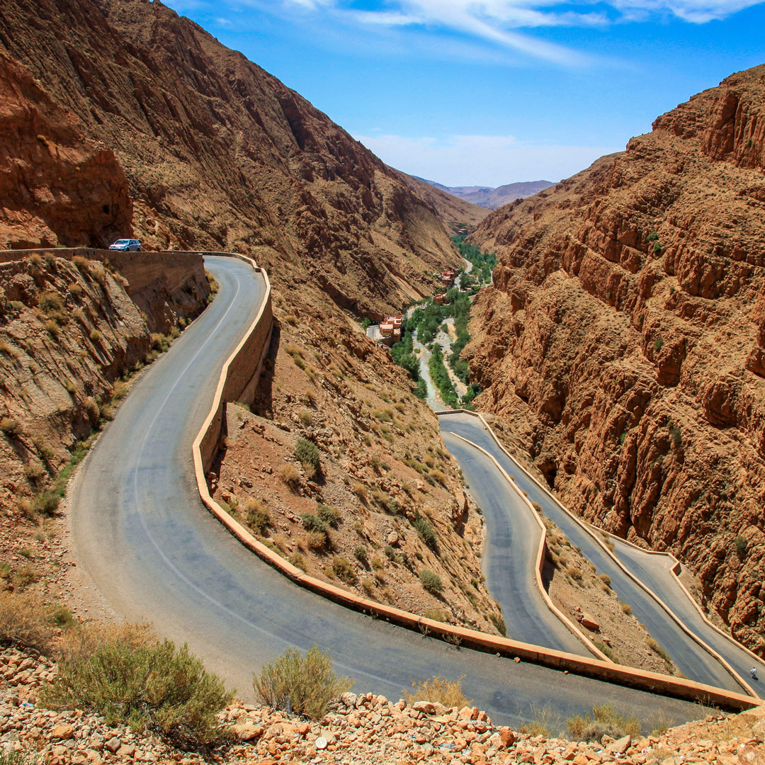 a switchback road winding through the Todra Gorge