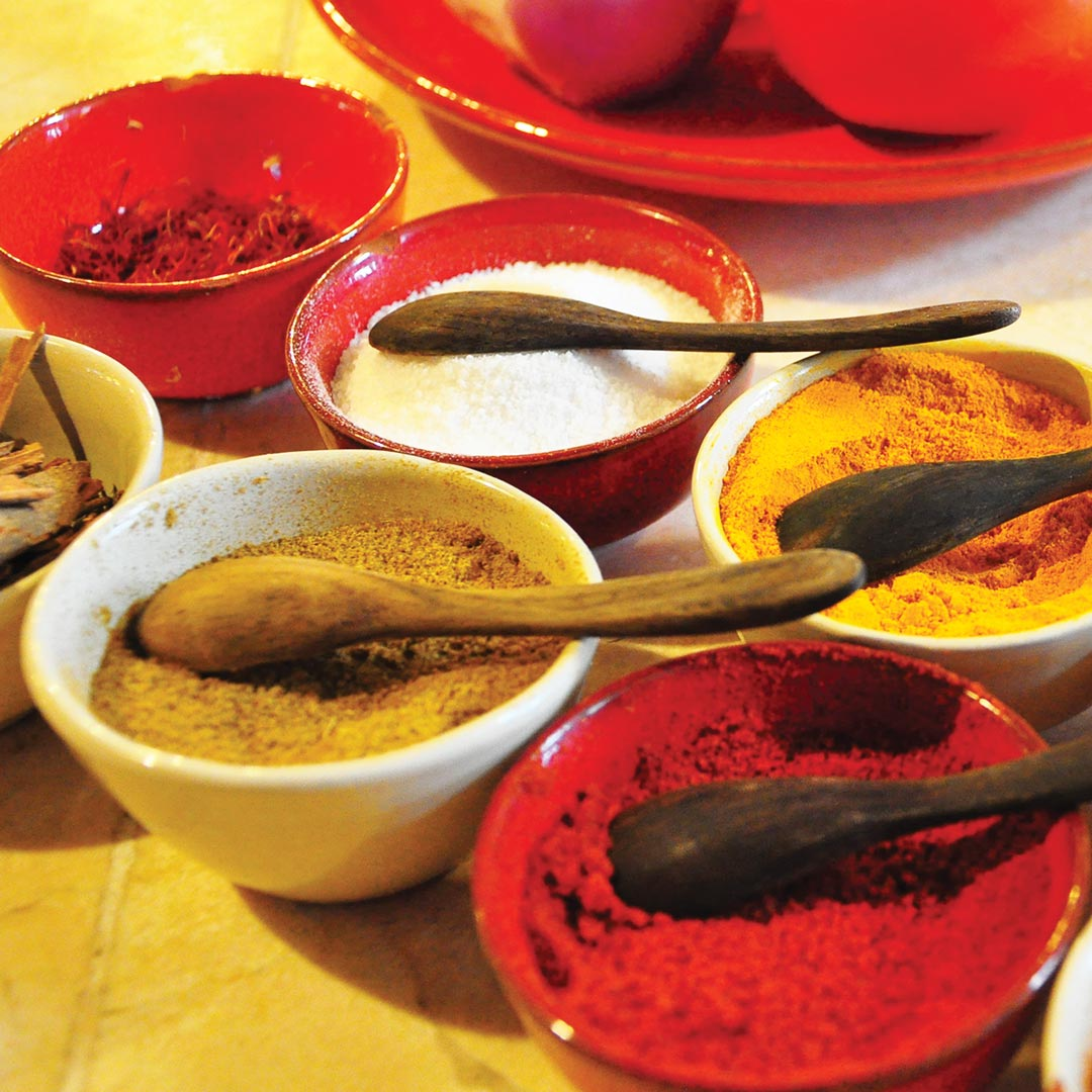 colorful array of ground cooking spices