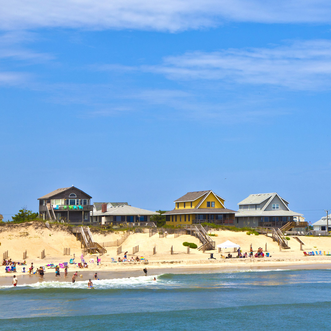 people playing on the beach in front of cottages at Nags Head in North Carolina