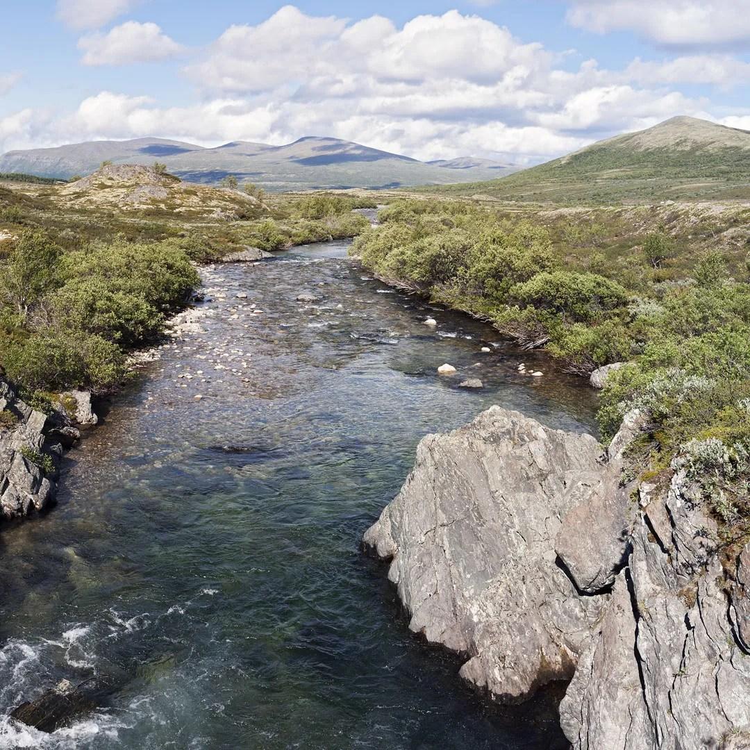 a crisp blue river runs through Dovrefjell-Sunndalsfjella National Park