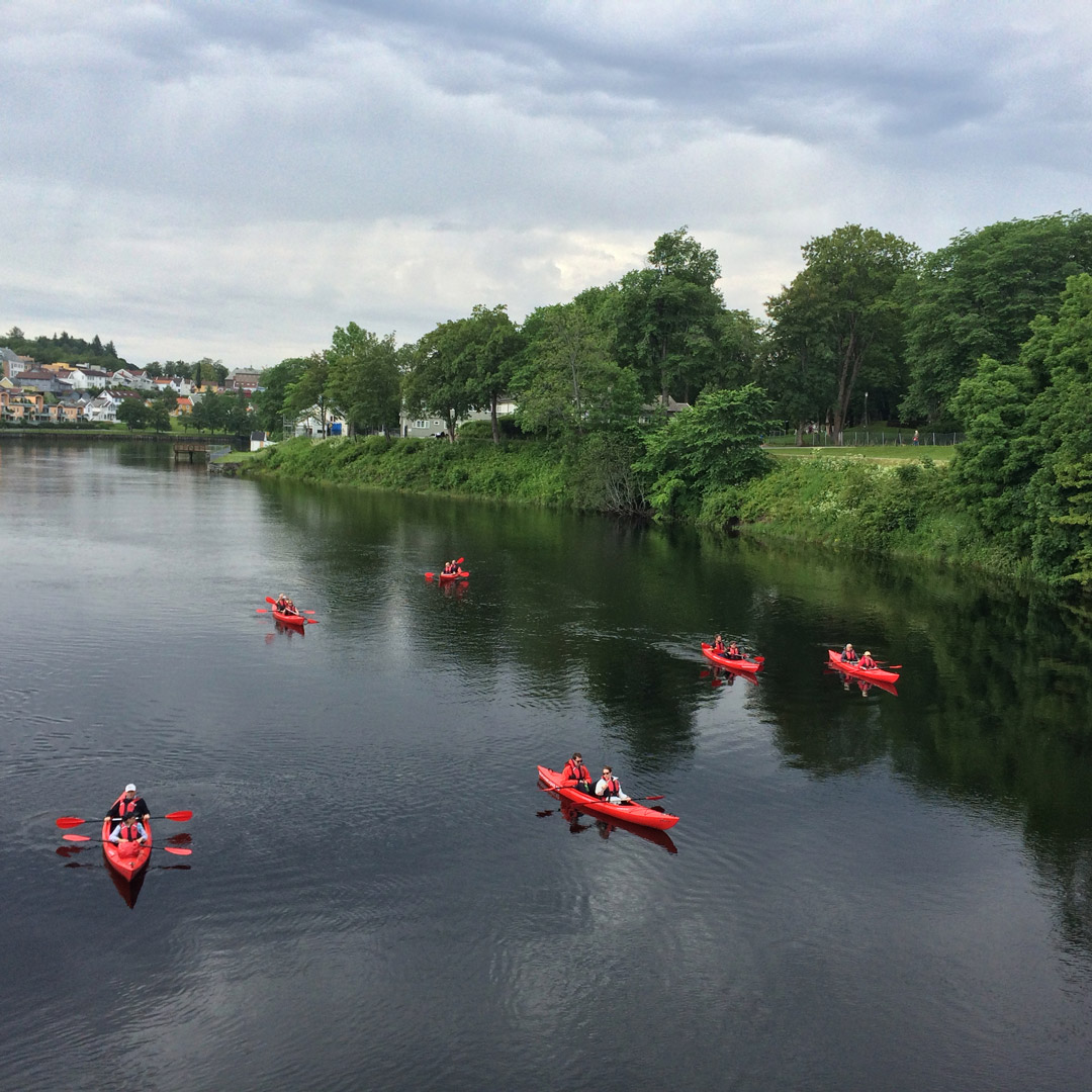 bright red kayaks on a river in Trondheim, Norway
