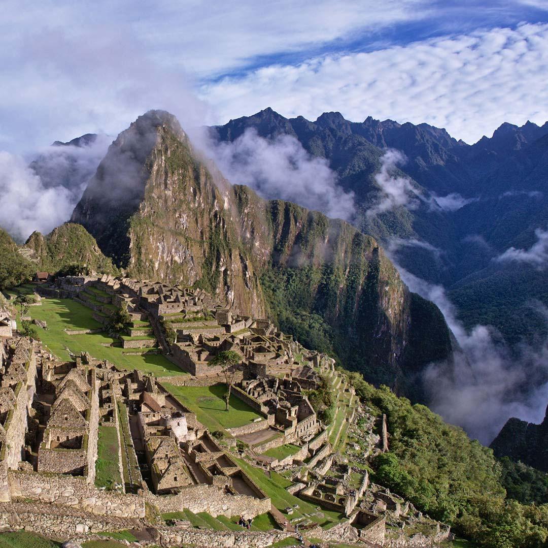 Mist surrounding Machu Picchu with Huayna Picchu behind it