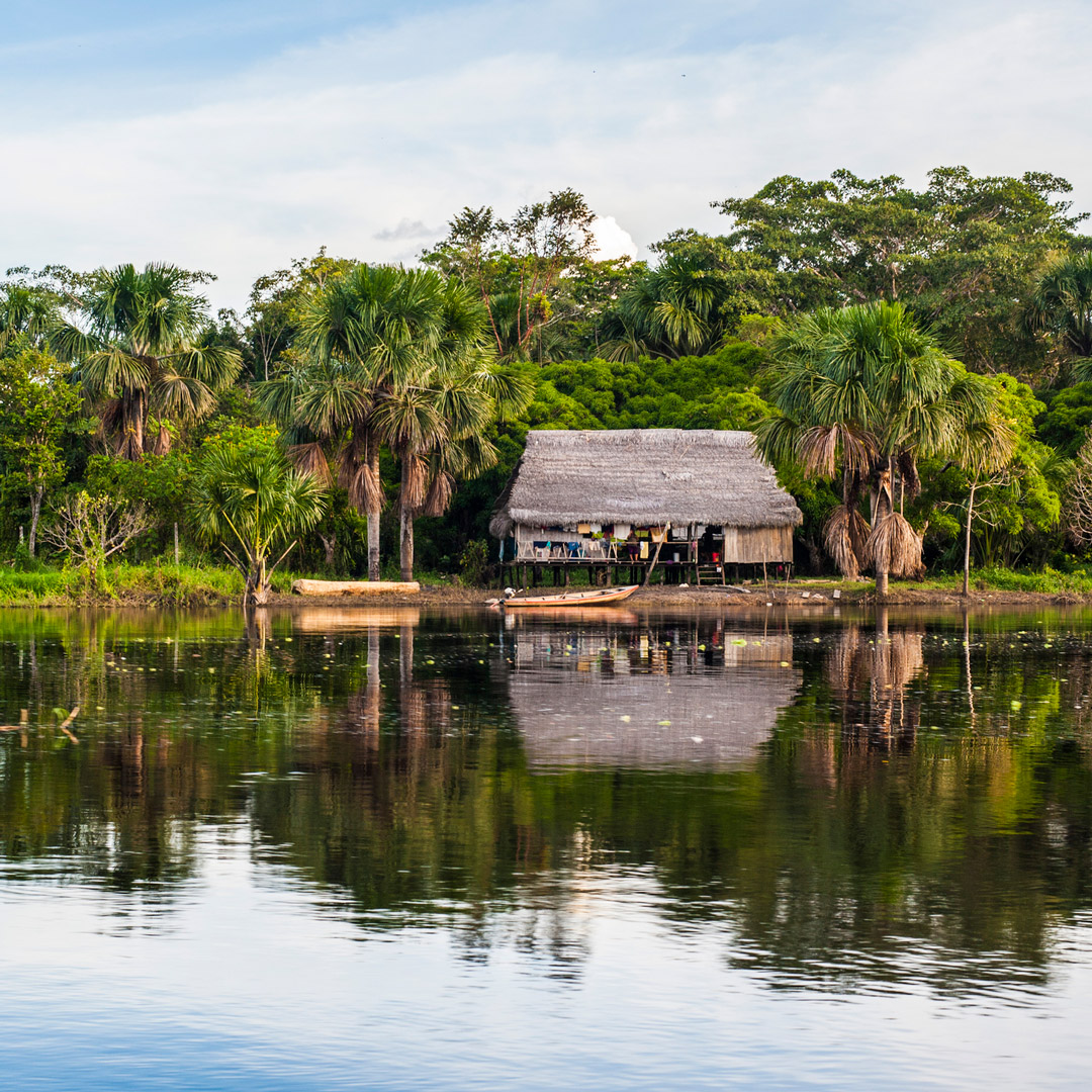 a weathered building sits on the Maranon River in Pacaya Samiria National Park in Peru