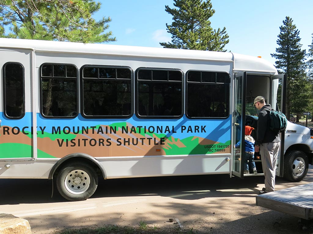 child and adult board the shuttle in Rocky Mountain National Park