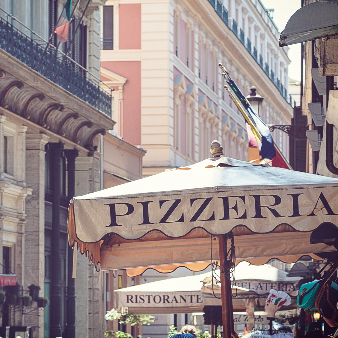 umbrella labeled with pizzeria in Rome