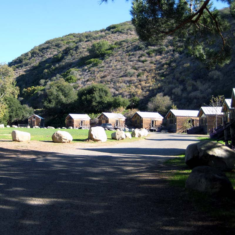 cabins lined up under a hill