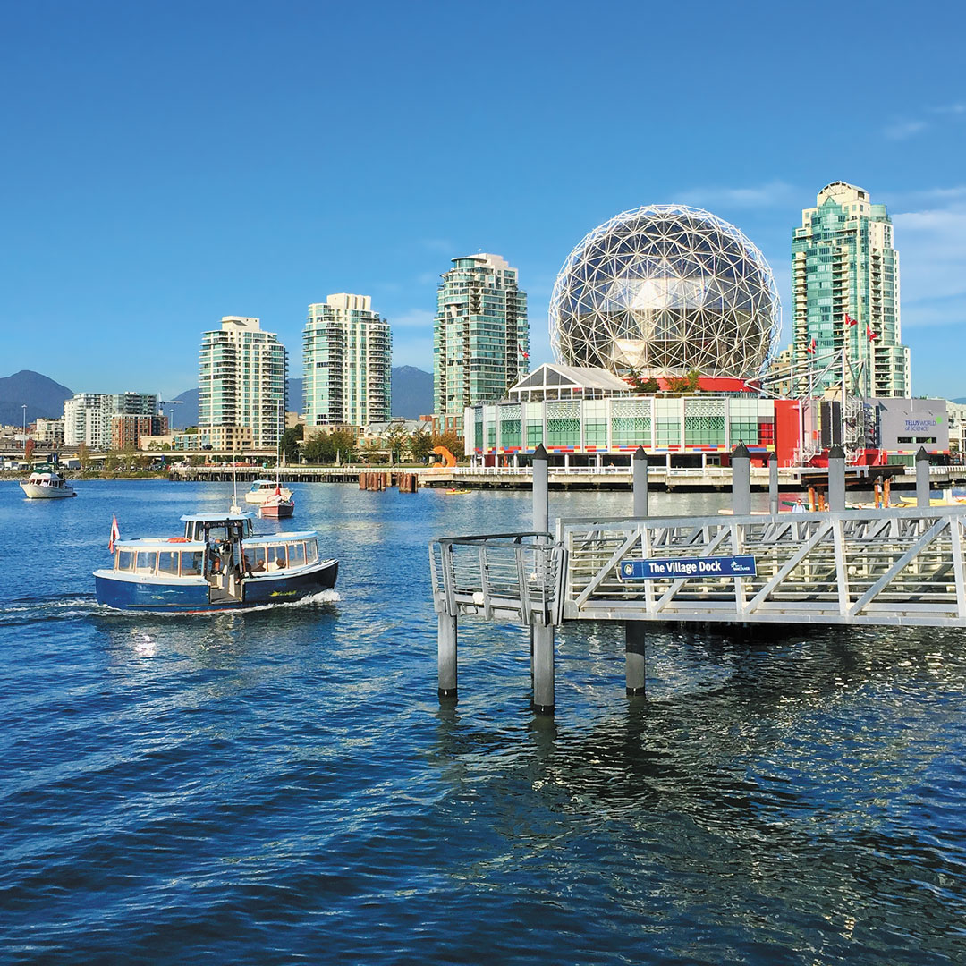 a ferry boat in false creek with Science World in the background, Vancouver