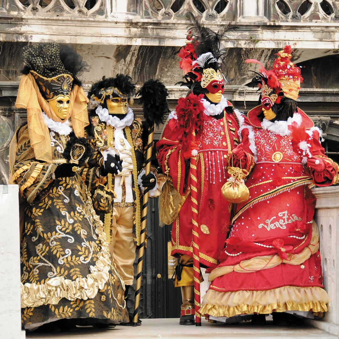 four people dressed in Carnivale costumes
