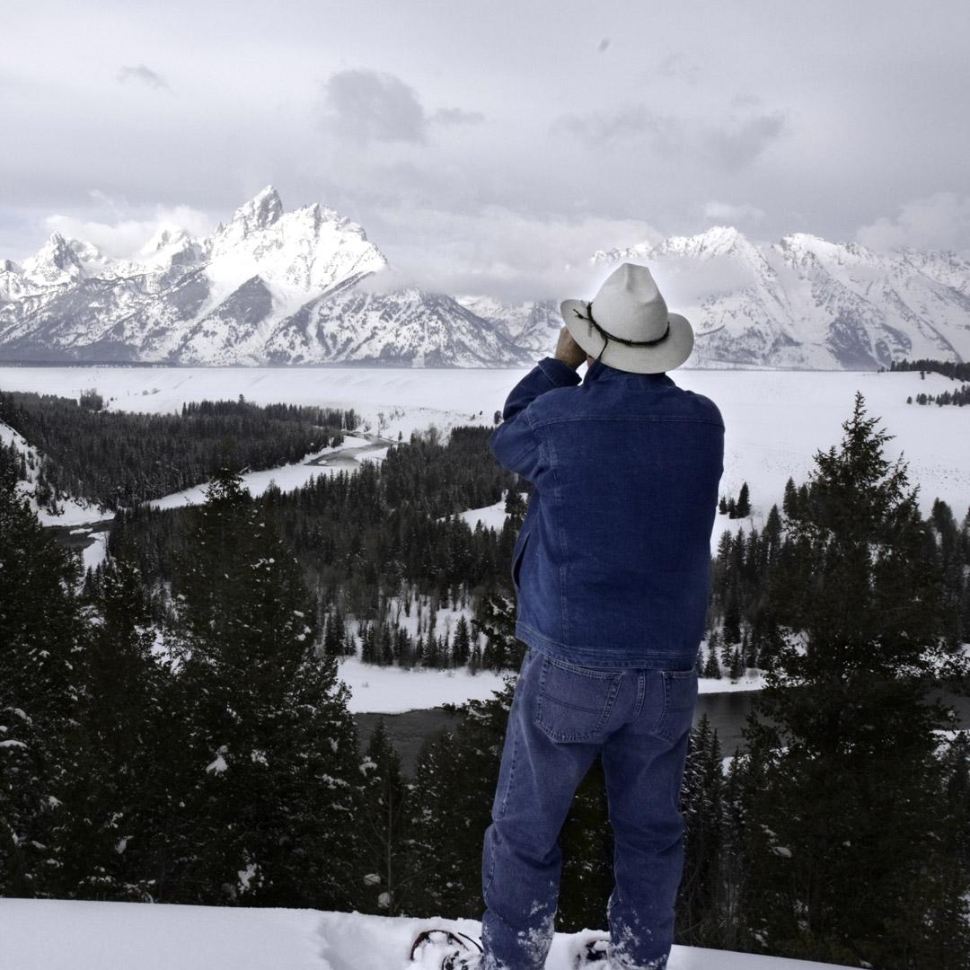 man in denim snowshoeing in grand teton national park