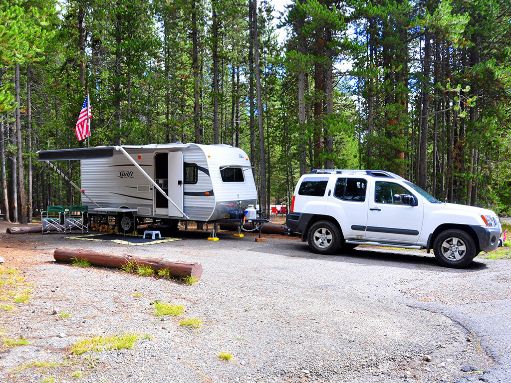 suv hitched to a travel trailer in a campground