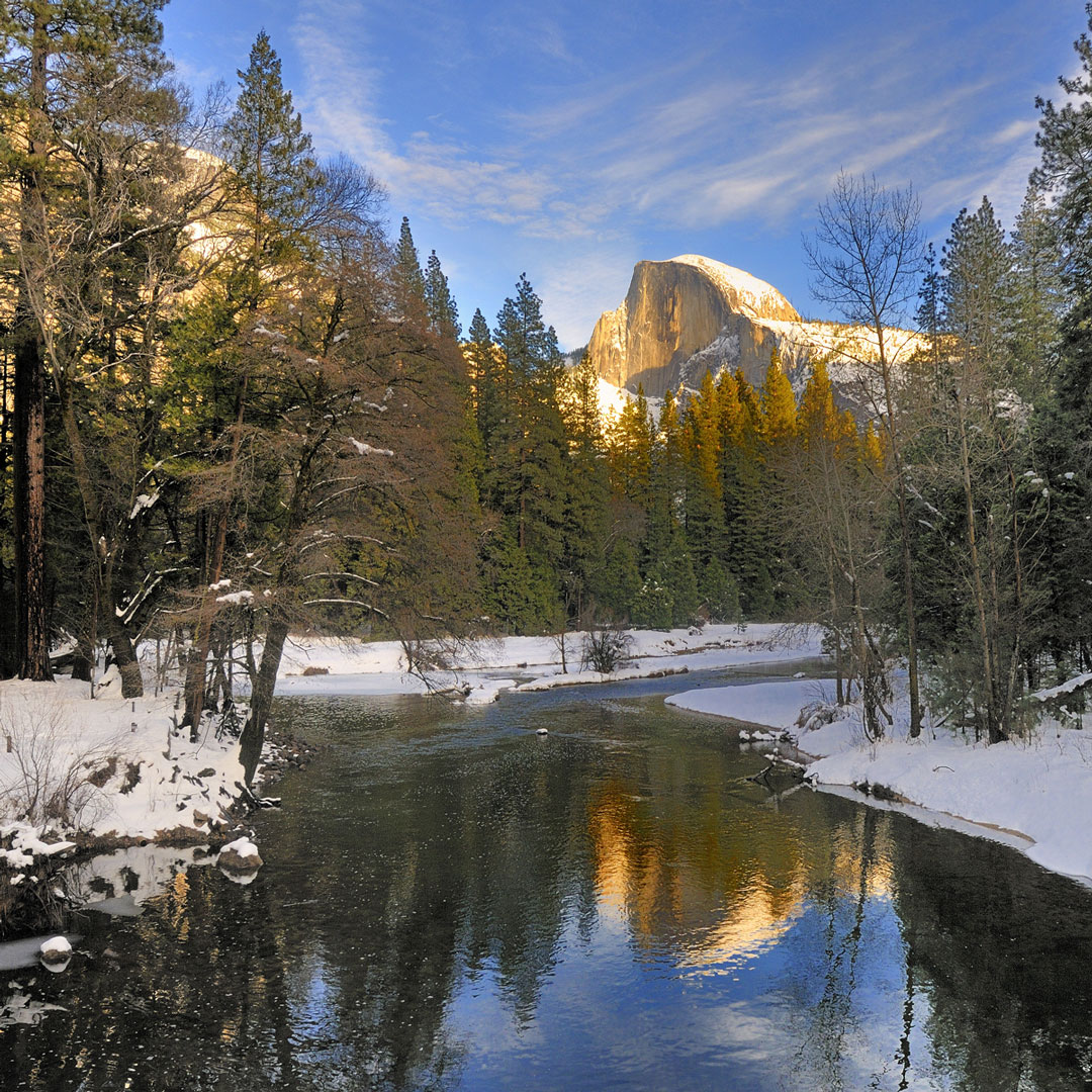 Half Dome reflecting on the merced river in Yosemite during winter