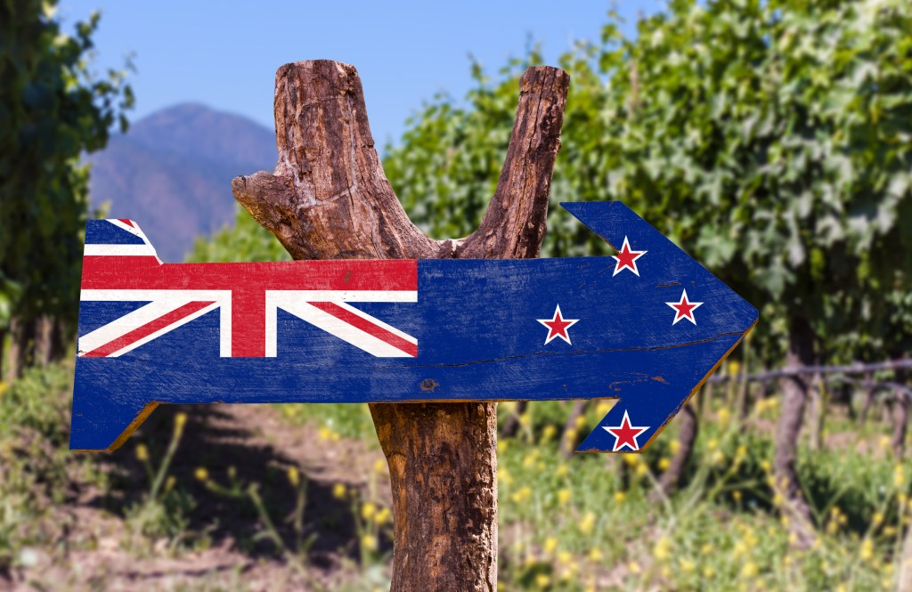 wooden sign of the New Zealand flag in a vineyard